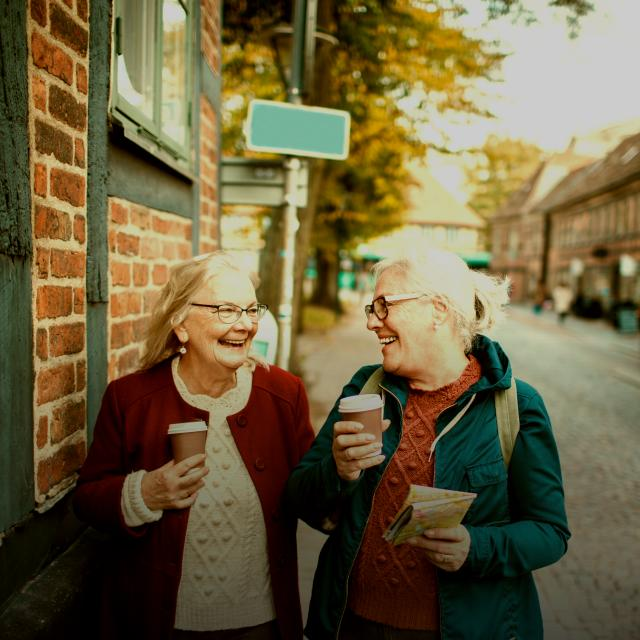 Two women talking on the street