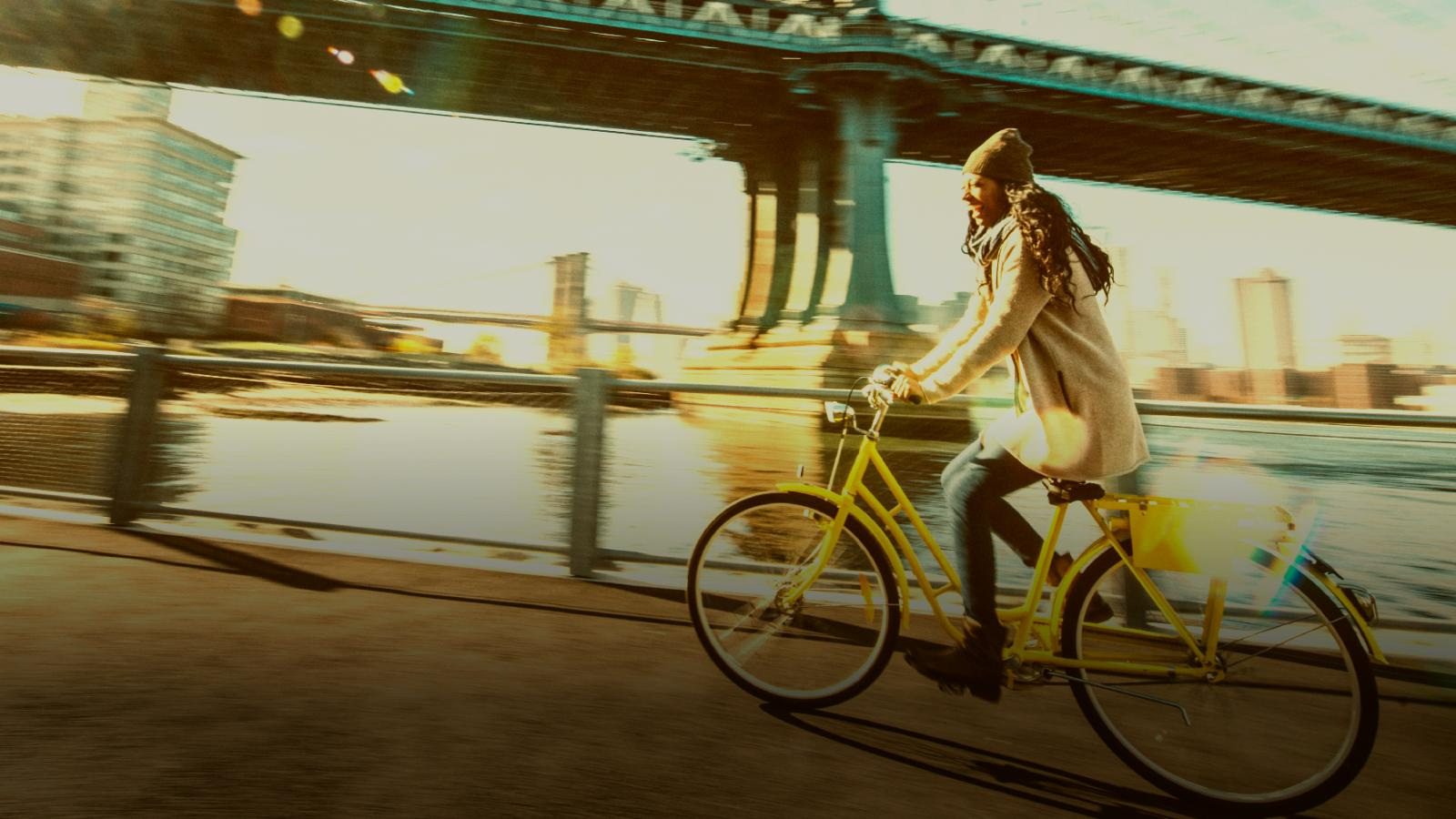 woman cycling yellow bicycle